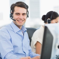 tech support man with headset at computer